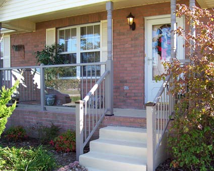 Glass railings on front porch look great