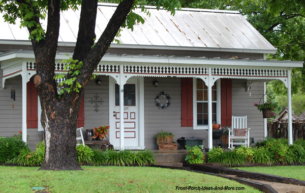 cozy home with metal roof and charming front porch with exterior house trim