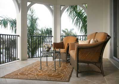 tiled porch floor with moroccan flair with wicker furniture