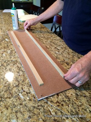 To prevent warping from moisture, Dave glued two skinny boards to the back of the banner