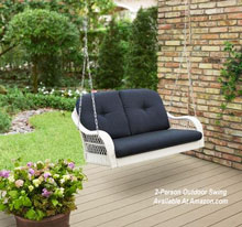 two person wicker porch swing with blue cushion