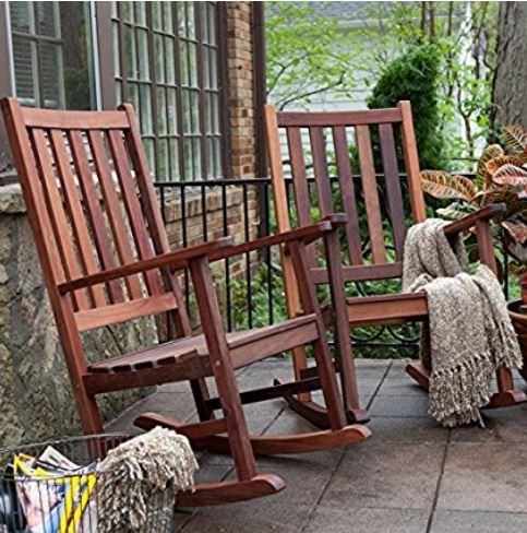 two sophisticated wood rocking chairs with throws on front porch