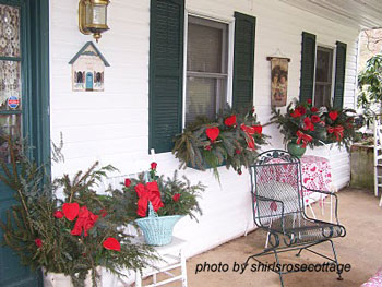 Valentine front porch with colorful evergreens and red ribbons