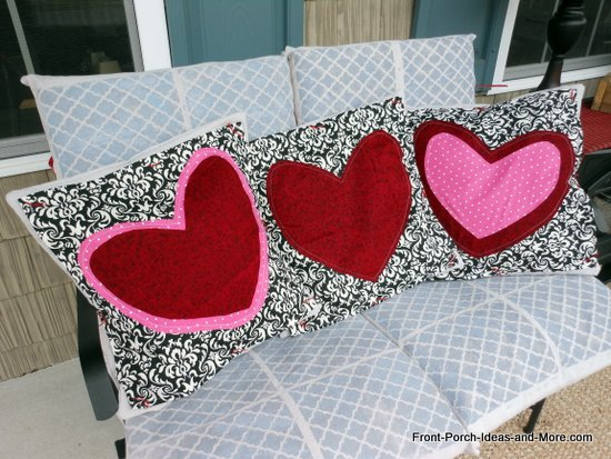 Valentine pillows on our porch glider