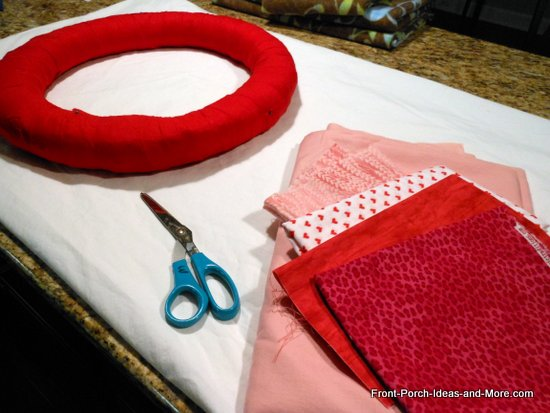 Valentine wreath craft - straw wreath covered with red fabric