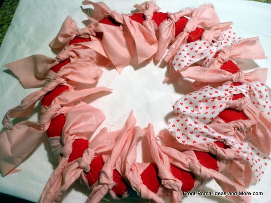 valentine wreath - I continued to add in different valentine fabrics