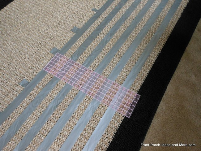 laying down the vertical stripes on the rug first