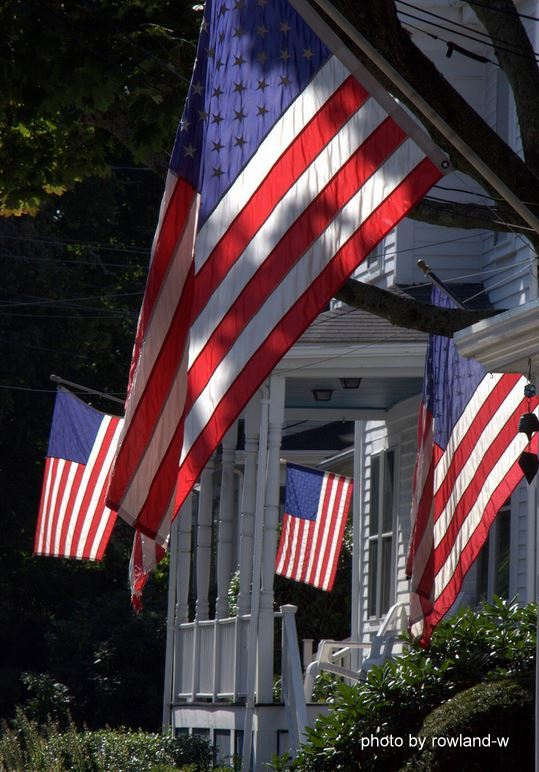 American Flags flying on several front porches
