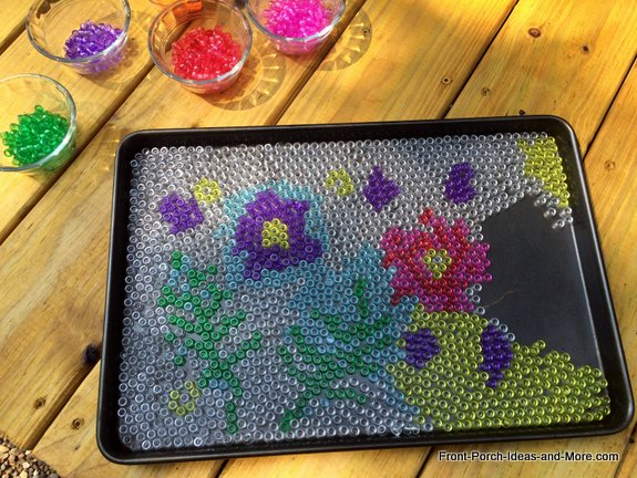 Cool garden art - filling in the art with yellow pony beads