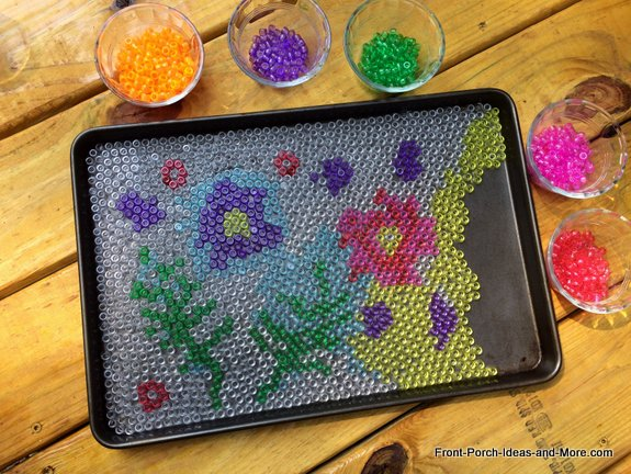 Cool garden art - filling in the art with the rest of the yellow pony beads
