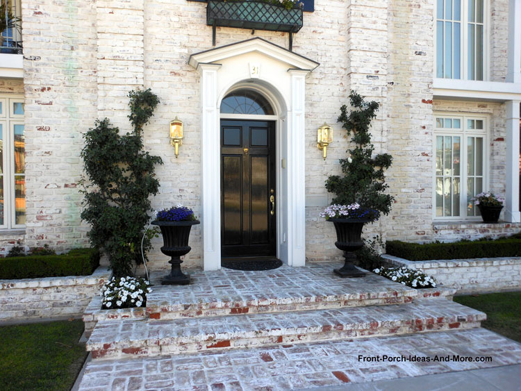 white-washed brick front porch steps