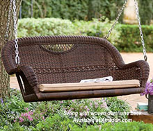 wicker porch swing with demilune back on porch