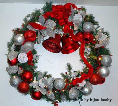 hand made wreath with delightful red bells