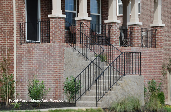finished concrete porch steps with wrought iron railings
