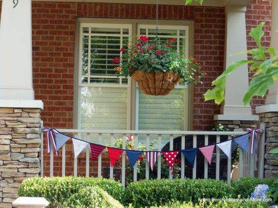 Patriotice garland on porch railings