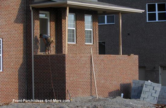 brick front porch before building concrete steps