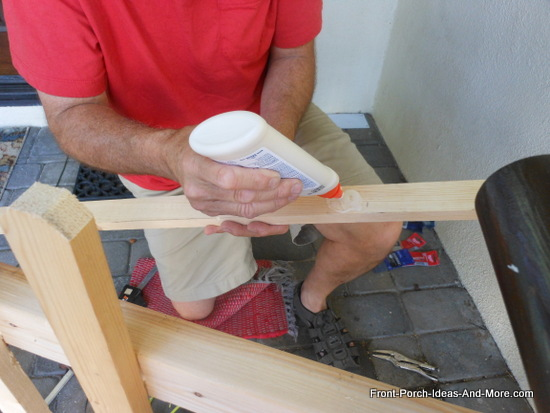 placing glue on pickets before assembly