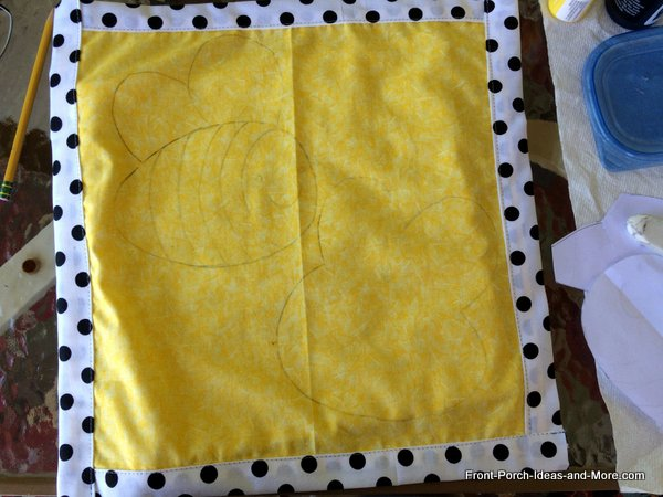 Bumble bee is lightly sketched onto the pillow topper