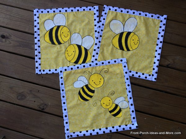 Three bumble bee pillow toppers for our summer porch
