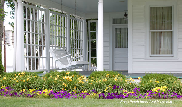 bush bean front porch with white porch swing and colorful flowers