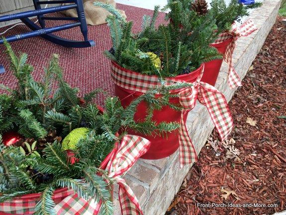 holiday decorative buckets with greenery