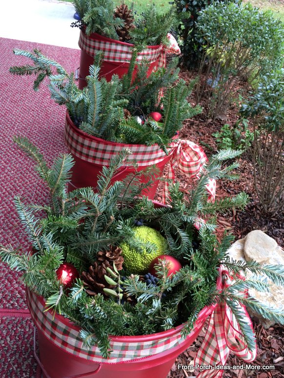 inexpensive buckets filled with Christmas greenery