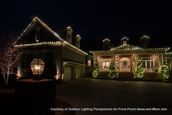 home outlined in holiday lights