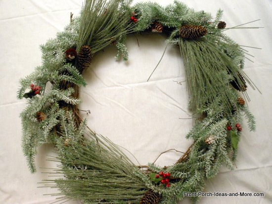 evergreen picks tucked into the grapevine wreath