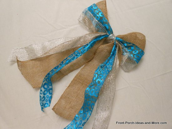 bow made from burlap, aqua and silver ribbons