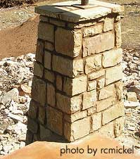 a stone column being built