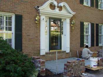 Large beautiful brick home before porch remodel