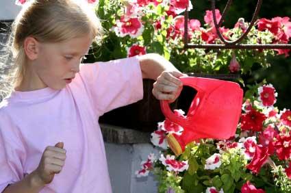 girl watering flowers
