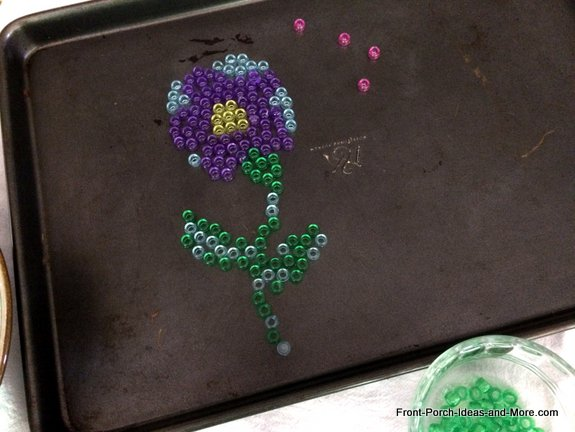 Cool garden art - I started by making a simple flower pattern on the cookie sheet