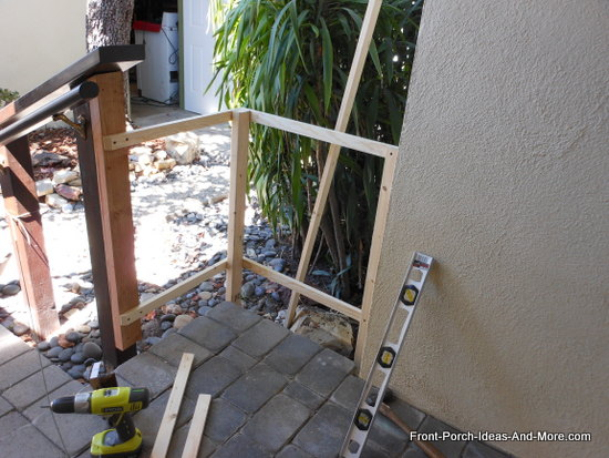 picket fence frame attached to 2x4 and secured in the ground