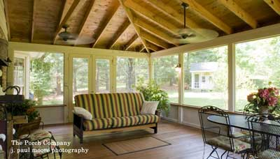 Custom screen porch with ceiling fan and wall lights