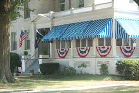 American and Navy flags with buntings on porch