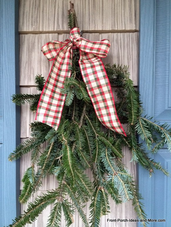 fresh greenery swag tied with ribbon for Christmas decoration