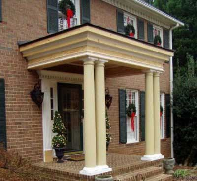 Picture of Susan's front porch being remodeled - Christmas time