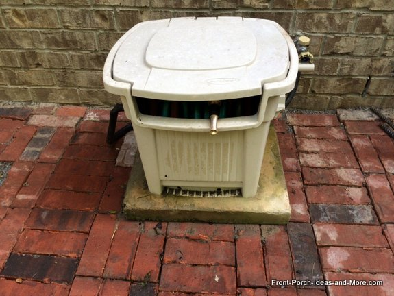 garden hose storage box on concrete base