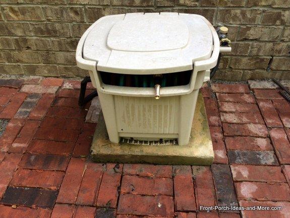 garden hose storage box on concrete base