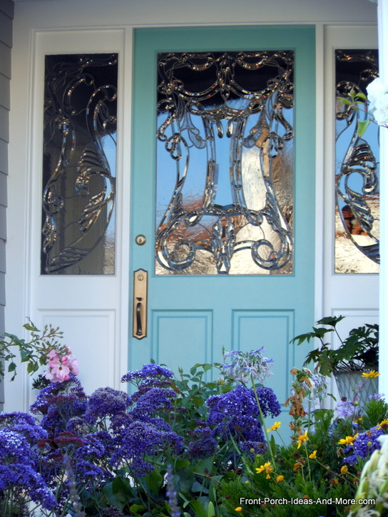 blue front door with leaded glass