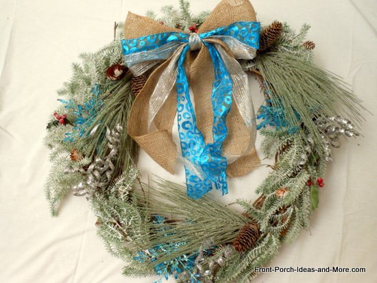 bow is attached to the wreath with floral wire