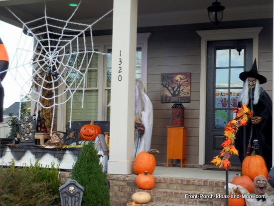 Giant spider web hanging on porch