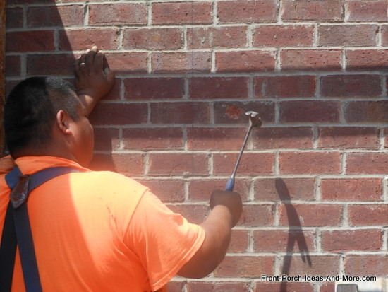 knocking out brick to accept concrete