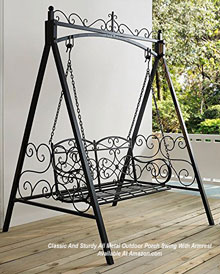 Decorative scrolled porch swing on stand at amazon