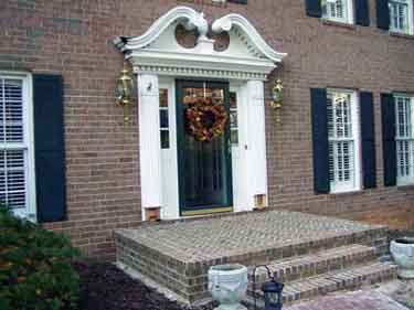 Large front porch deck on brick house - herringbone pattern
