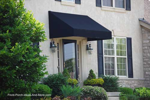 nice awning over front door on beautiful home