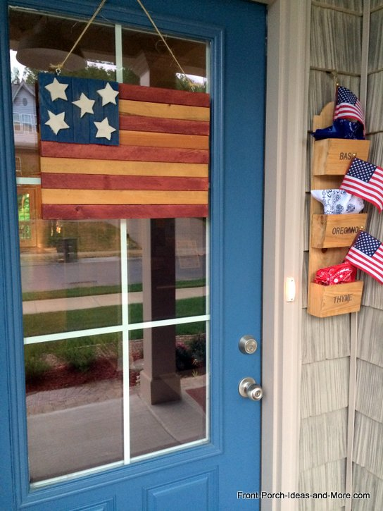 Our front door for Memorial Day with a wooden vintage flag