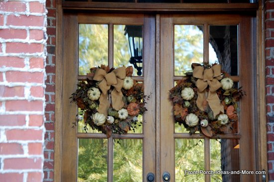 natural fall wreaths with mini pumpkins, dried leaves and light tan ribbons