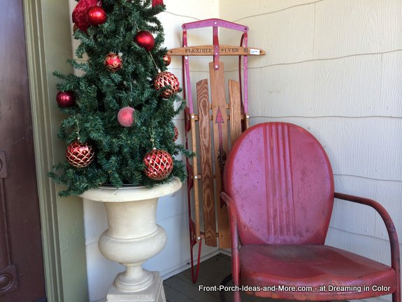 Christmas vignette - vintage sled, retro metal bouncer and Christmas tree
